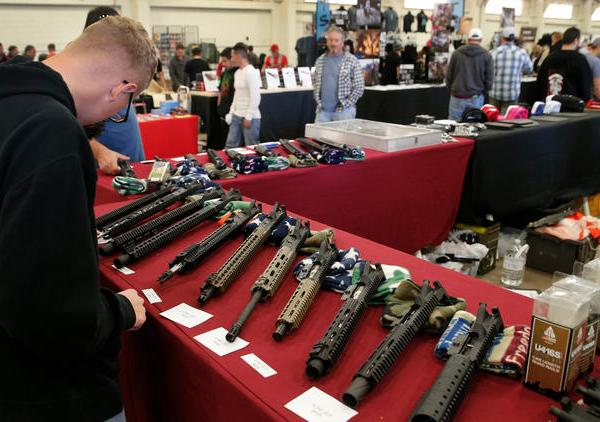 This file photo shows AR-15 semi-automatic assault rifle upper receiver parts and kits at the Crossroads of The West Gun Show in Del Mar on Dec. 12, 2015. (Los Angeles Times)
