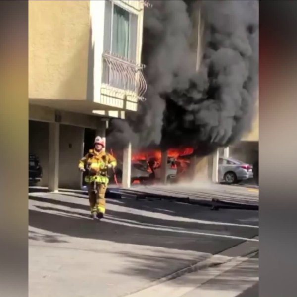 A Los Angeles firefighter is shown on the scene of a condo fire in North Hollywood on October 21, 2017. (Credit: LoudLabs)
