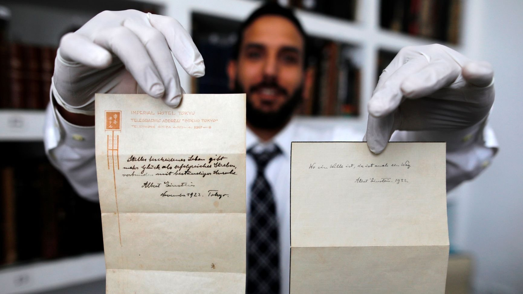 Two handwritten notes penned by Albert Einstein have been sold at auction for a combined $1.8 million. (Credit: Menahem Kahana/AFP/Getty Images)