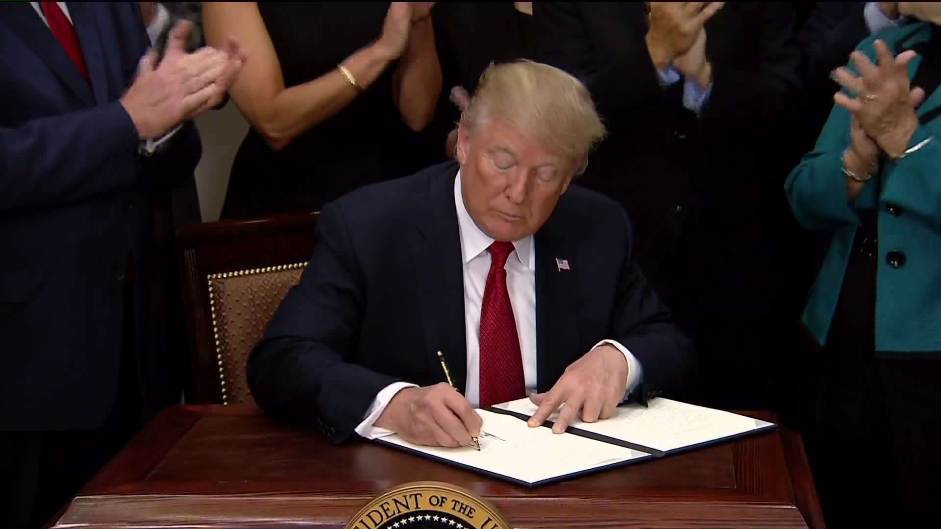President Trump signed an executive order on health care at the White House on Oct. 12, 2017. (Credit: Pool)
