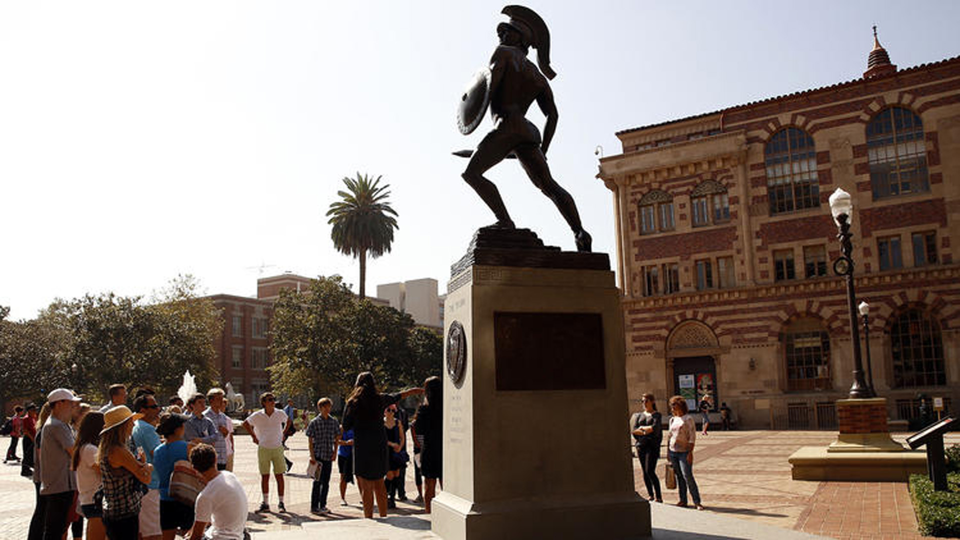 In this undated file photo, people gather around the Tommy Trojan statue at the center of USC's campus. (Al Seib / Los Angeles Times)