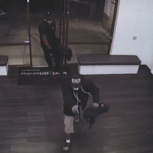 Two armed robbers are captured on surveillance footage at a Verizon store in Placentia on Nov. 4, 2017.