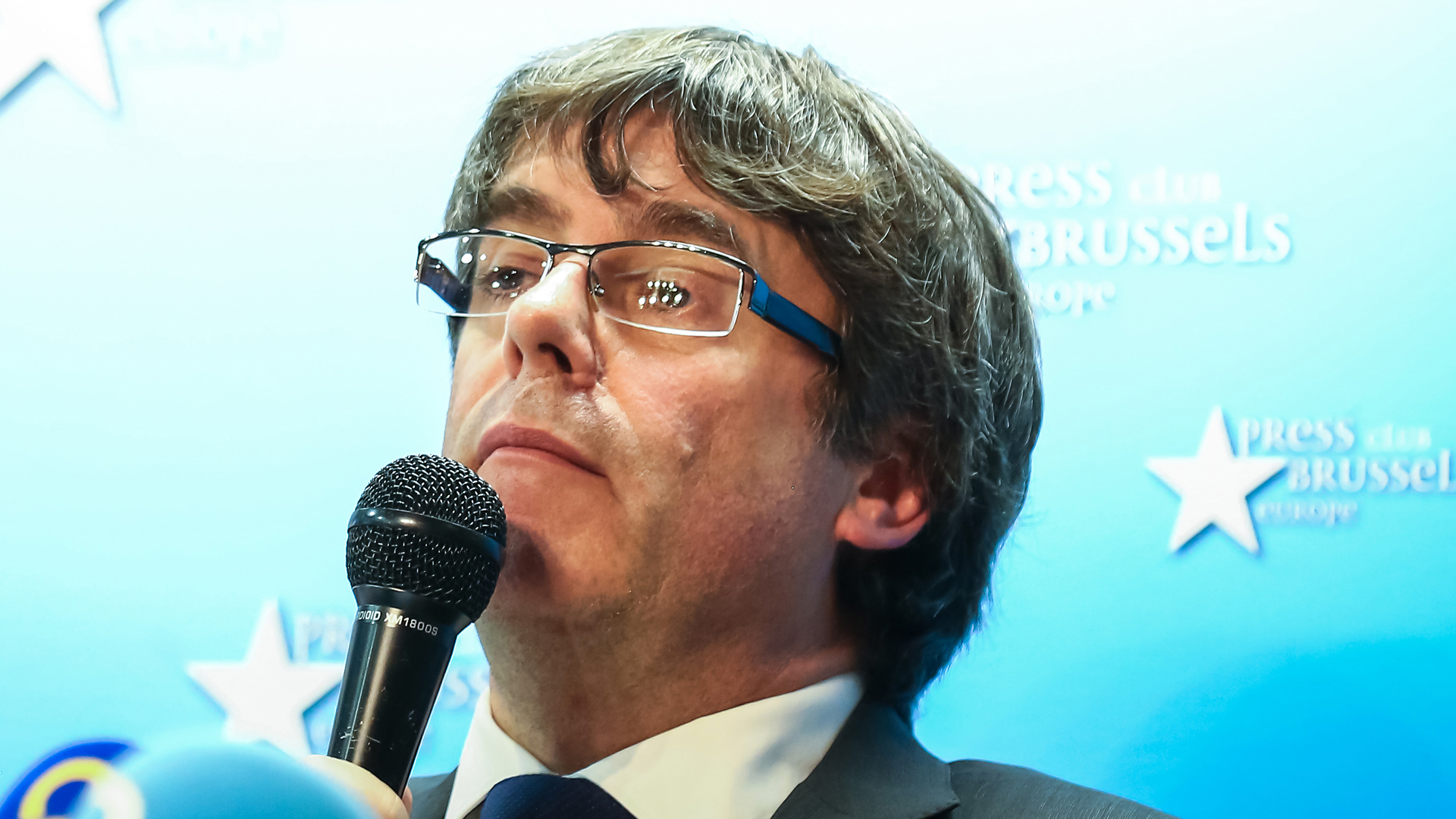 Catalonia's dismissed leader Carles Puigdemont, along with other members of his dismissed government, address a press conference at The Press Club in Brussels on Oct. 31, 2017. (Credit: Aurore Belot/AFP/Getty Images)