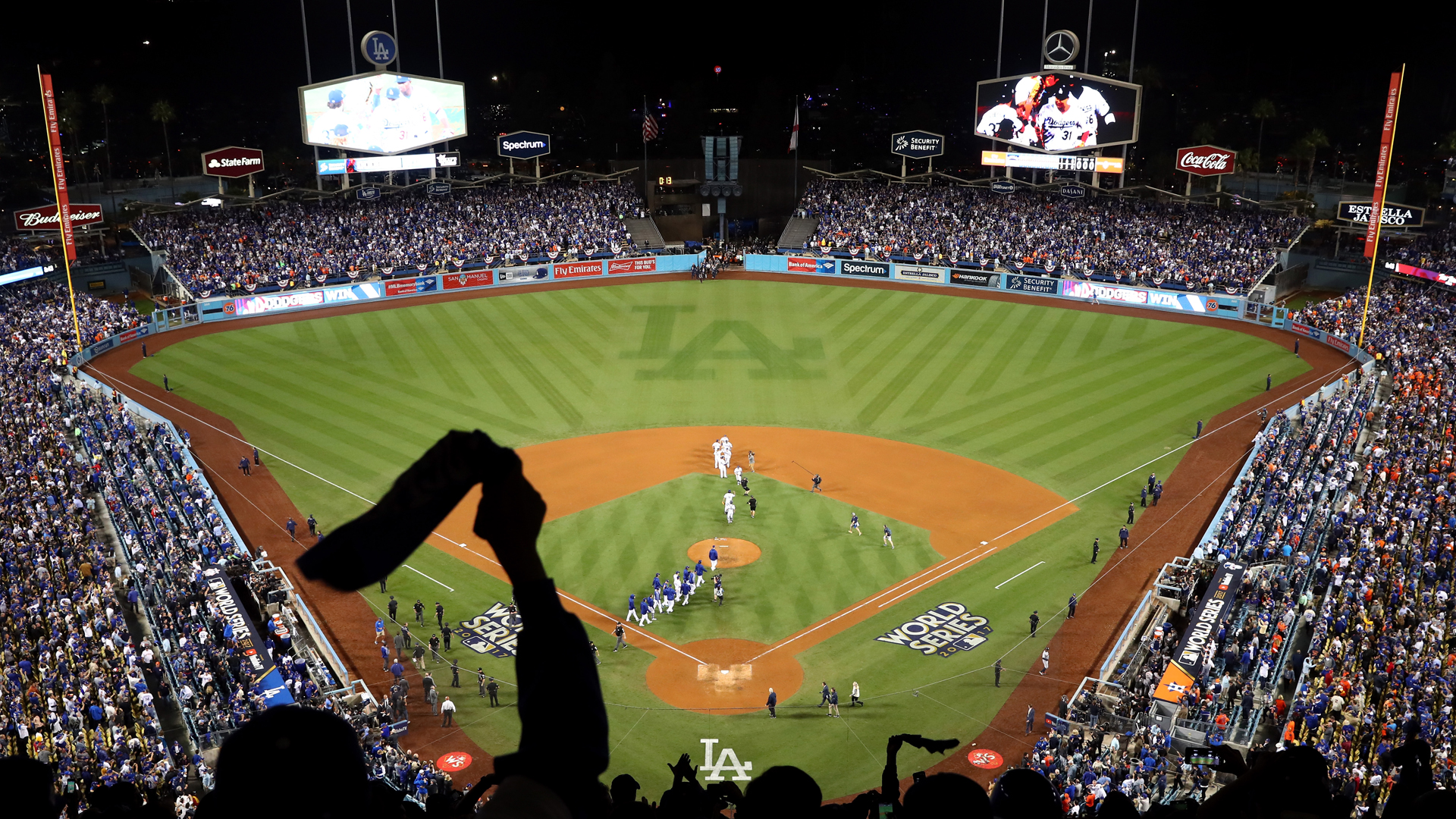 The Dodgers celebrate after defeating the Houston Astros 3-1 in game six of the 2017 World Series at Dodger Stadium on October 31, 2017 in Los Angeles. (Credit: Joe Scarnici/Getty Images)