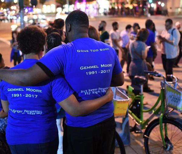 Friends and family of Gemmel Moore gather for a candelight vigil outside the West Hollywood sheriff's station in August, 2017. (Credit: Wally Skalij / Los Angeles Times)