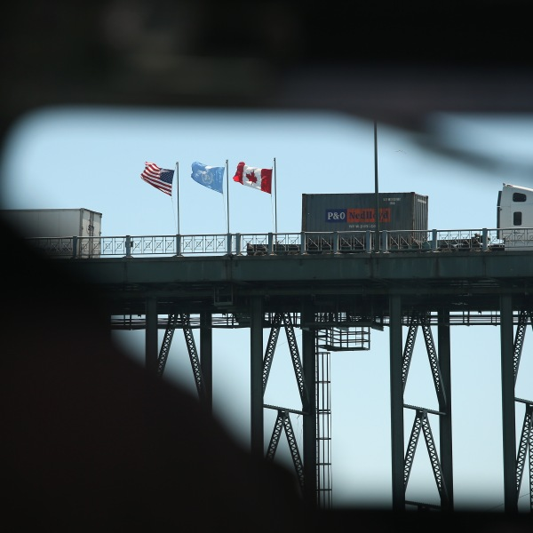 Freight crosses the Peace Bridge over the Niagara River forming the U.S.-Canada border on June 3, 2013, in Buffalo, New York. (Credit: John Moore / Getty Images)