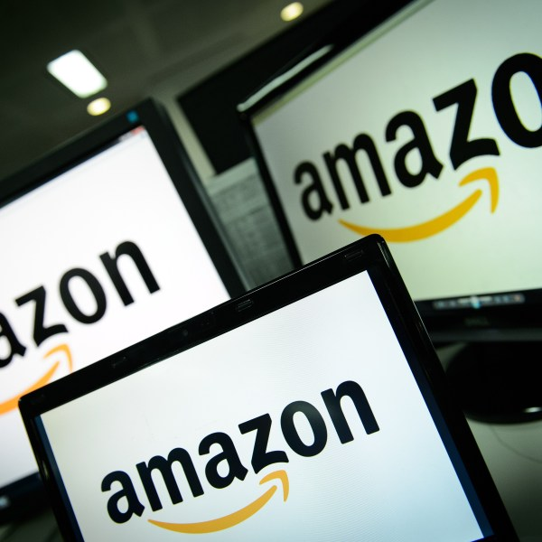A picture shows the logo of the online retailer Amazon dispalyed on computer screens in London on December 11, 2014. (Credit: LEON NEAL/AFP/Getty Images)
