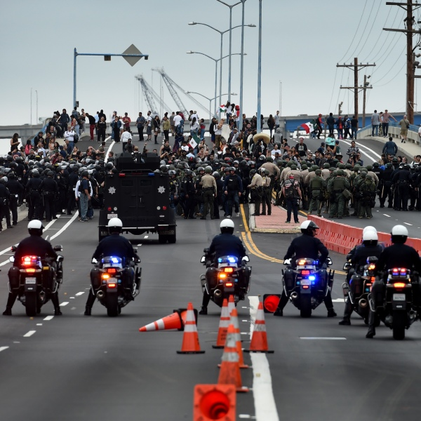 Anti-Trump protesters are moved away from the Convention Center after a rally outside Republican presidential candidate Donald Trump's event in San Diego on May 27, 2016. (Credit: Mark Ralston / AFP / Getty Images)