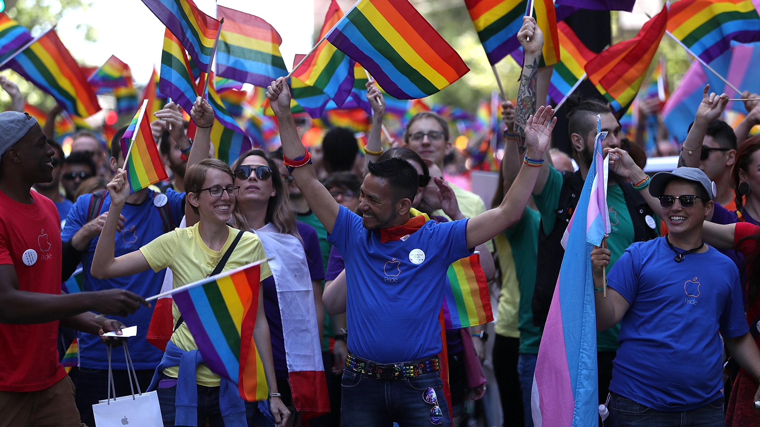 Parade participants wave pride flags during the 2016 San Francisco Pride Parade on June 26, 2016. (Credit: Justin Sullivan / Getty Images)