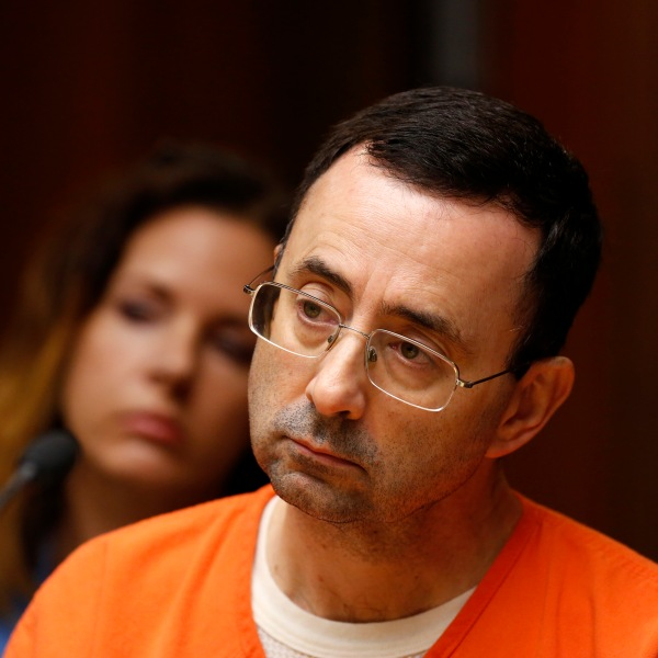 Former Michigan State University and USA Gymnastics doctor Larry Nassar is seen in the 55th District Court where Judge Donald Allen Jr. bound him over on June 23, 2017, in Mason, Michigan, to stand trial on 12 counts of first-degree criminal sexual conduct. (Credit: JEFF KOWALSKY/AFP/Getty Images)