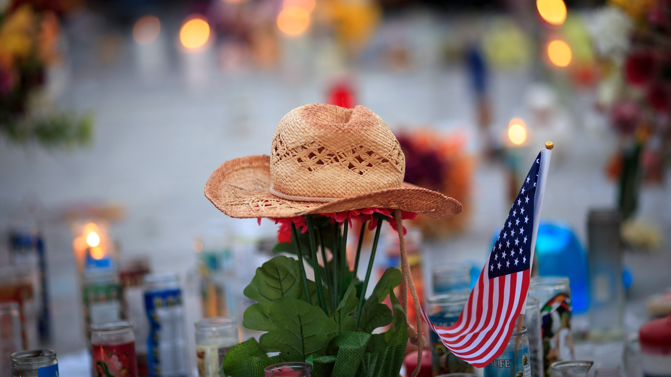 A hat is left at a makeshift memorial during a vigil to mark one week since the mass shooting at the Route 91 Harvest country music festival, on the corner of Sahara Avenue and Las Vegas Boulevard at the north end of the Las Vegas Strip, on Oct. 8, 2017. (Credit: Drew Angerer / Getty Images)