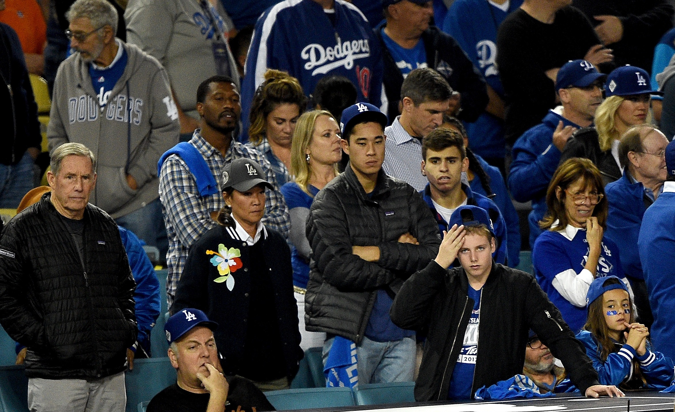 Los Angeles Dodgers fans react during Game 7 of the 2017 World Series between the Houston Astros and the Los Angeles Dodgers at Dodger Stadium on Nov. 1, 2017. (Credit: Kevork Djansezian/Getty Images)