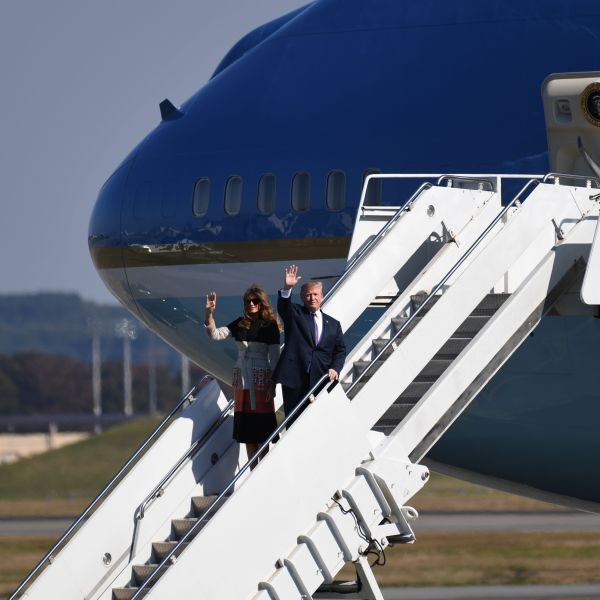 U.S. President Donald Trump and First Lady Melania Trump wave upon arriving at U.S. Yokota Air Base in Tokyo on Nov. 4, 2017. (Credit: Toshifumi Kitamura / AFP / Getty Images)