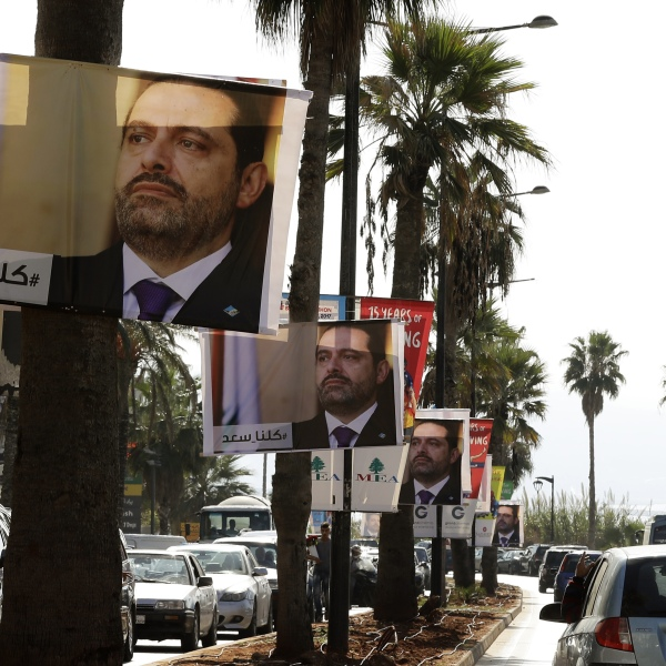 """Posters of Lebanese Prime Minister Saad Hariri, who resigned last week in a televised speech airing from the Saudi capital Riyadh, hang on Beirut's seaside corniche on Nov. 10, 2017, with a caption reading below in Arabic: """"#We_are_all_Saad"""". (Credit: Joseph Eid / AFP / Getty Images)"""