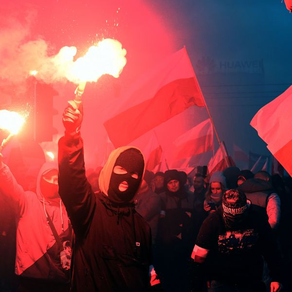 Demonstrators burn flares and wave Polish flags during the annual march to commemorate Poland's National Independence Day in Warsaw on Nov. 11, 2017. (Credit: Janek Skarzynski / AFP / Getty Images)
