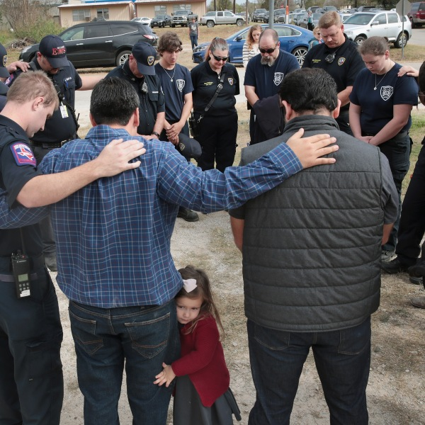 First responders share a prayer following a Veterans Day ceremony outside the community center in Sutherland Springs, Texas, on Nov. 11, 2017. (Credit: Scott Olson / Getty Images)
