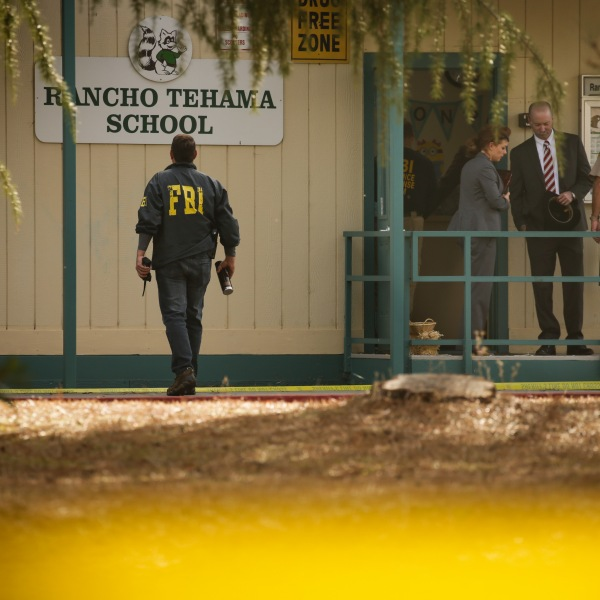 FBI agents are seen behind yellow crime scene tape outside Rancho Tehama Elementary School after a shooting on the morning of Nov. 14, 2017. (Credit: Elijah Nouvelage / AFP / Getty Images)