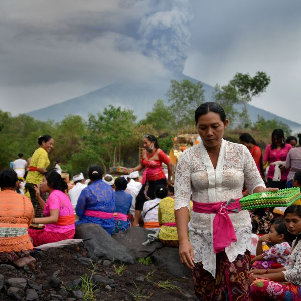 Balinese Hindus take part in a ceremony, where they pray near Mount Agung in hope of preventing a volcanic eruption, in Muntig village on Indonesia's resort island of Bali, Nov. 26, 2017. (Credit: Sonny Tumbelaka / AFP / Getty Images)