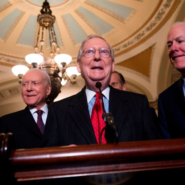 Senate Majority Leader Mitch McConnell alongside Senate Majority Whip John Cornyn (far right), Sen. John Barrasso (left) and Sen. Orrin Hatch (second left), speaks after a meeting between President Donald Trump and the Republican Senate Caucus in Washington, DC, Nov. 28, 2017. (Credit: Saul Loeb / AFP / Getty Images)