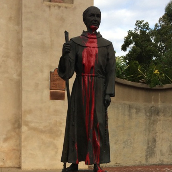 A vandalized statue of Junipero Serra is shown in a photo provided by the San Gabriel Police Department on Nov. 3, 2017.