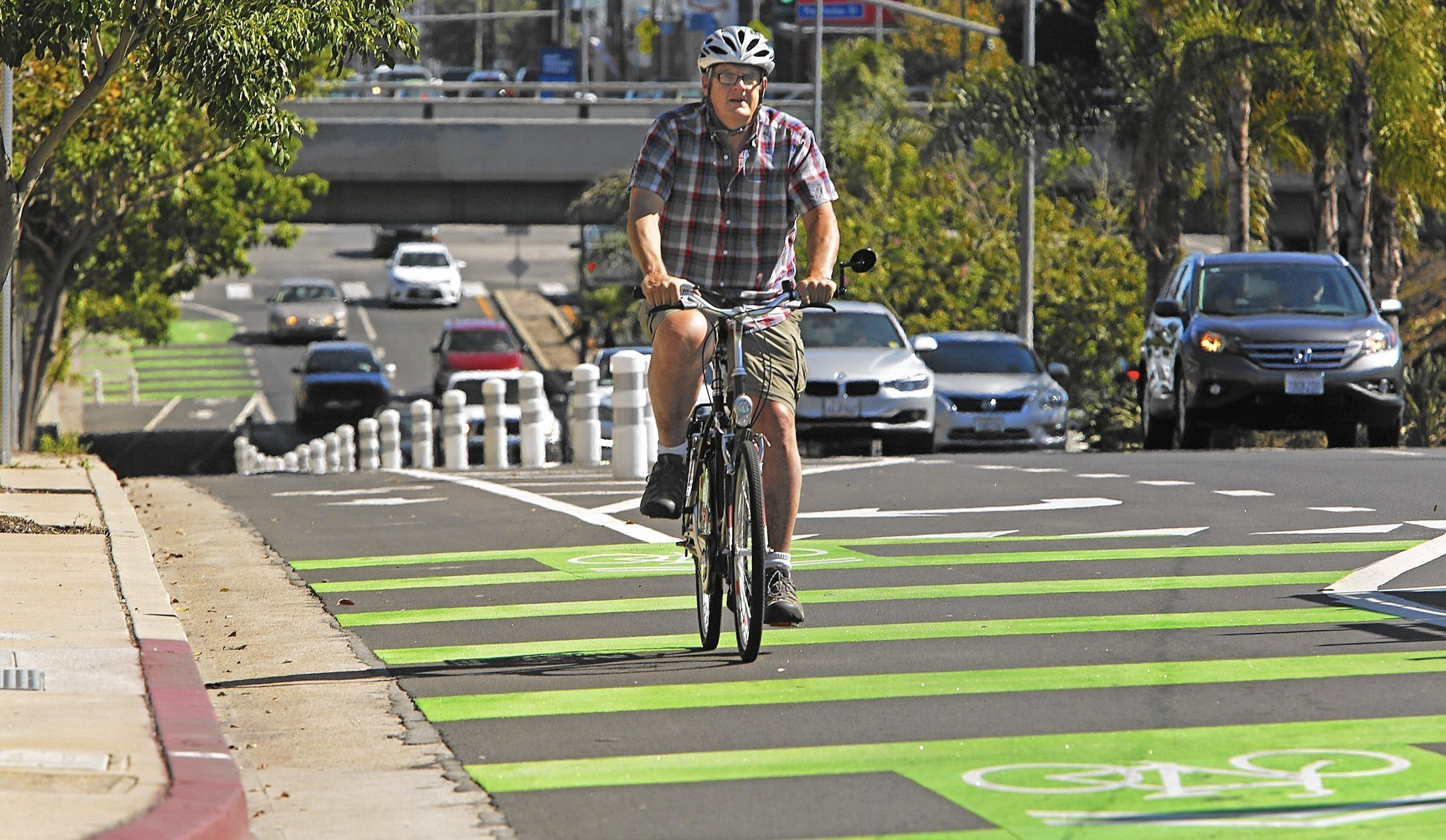 An undated file photo shows a protected bike lane on Reseda Boulevard in Northridge. (Credit: Anne Cusack / Los Angeles Times)
