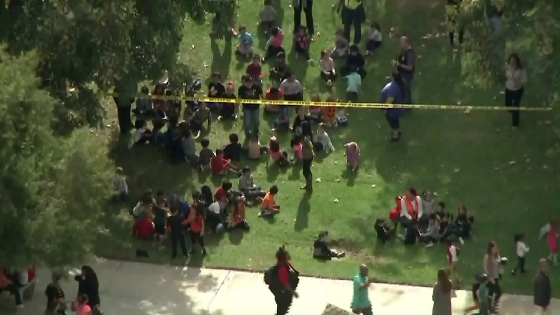 Students at Castleview Elementary School are evacuated after one of their teachers was taken hostage in a classroom on Oct. 31, 2017. (Credit: KTLA)