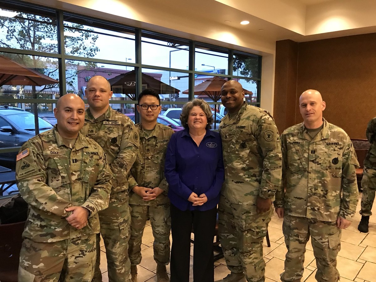 Betty Porto is shown flanked by veterans in this photo tweeted by Porto's Bakery on Nov. 10, 2017.