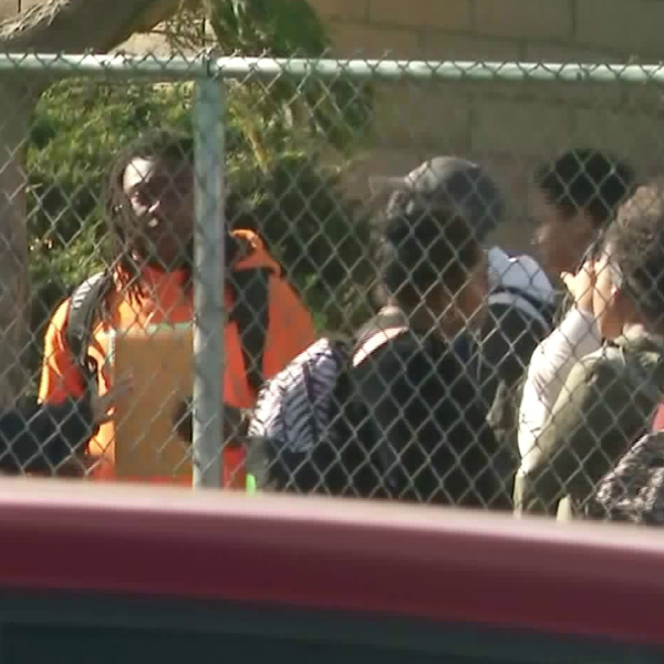 Students are seen leaving Serrano High School in Phelan on Nov. 17, 2017, just as outrage over some students making racist gestures and statements as shook the campus. (Credit: KTLA)