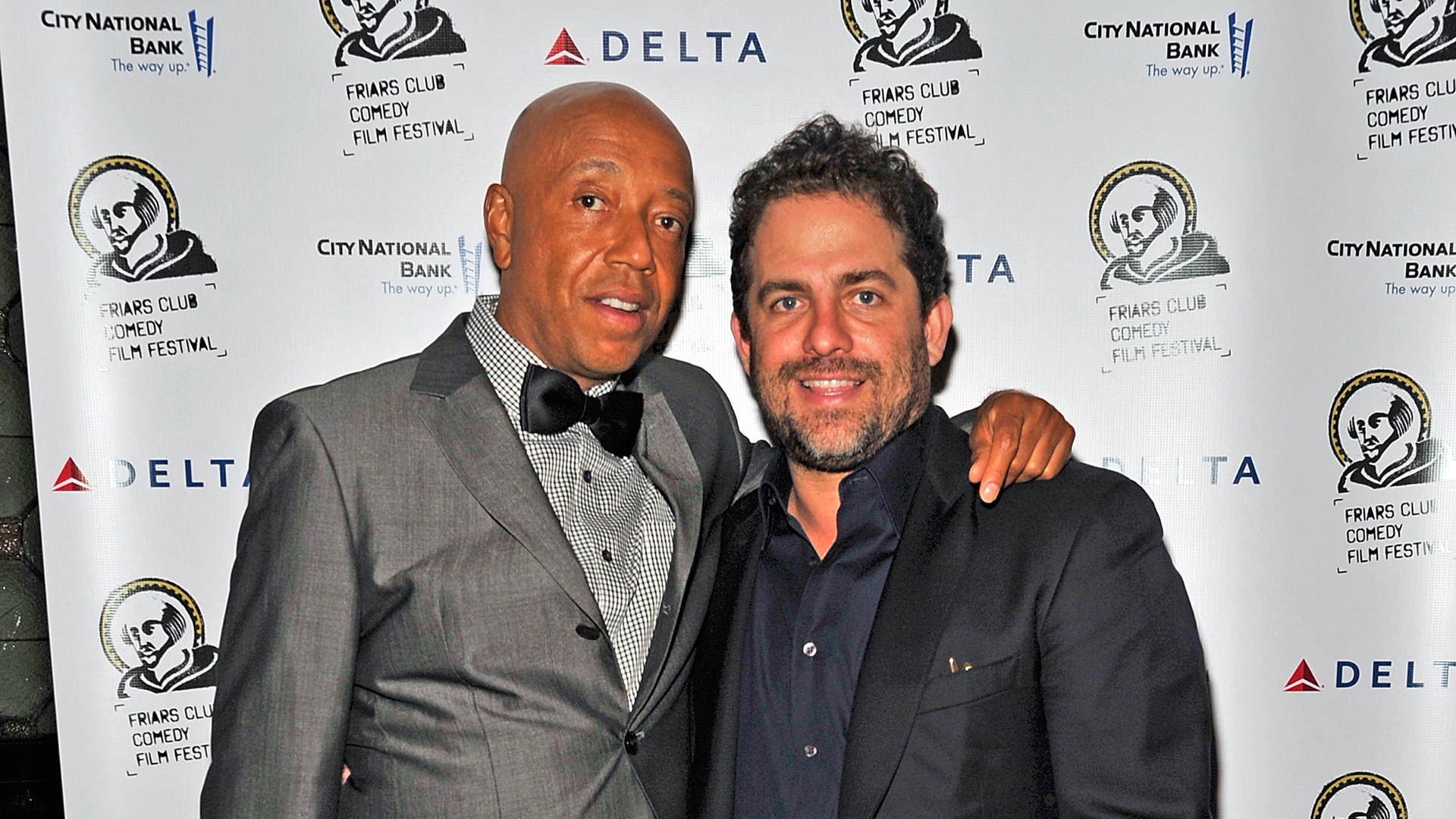 American business magnate Russell Simmons and director Brett Ratner attend the 2011 Friars Club Comedy Film Festival at the New York Friars Club on October 15, 2011. (Credit: Joe Corrigan/Getty Images)