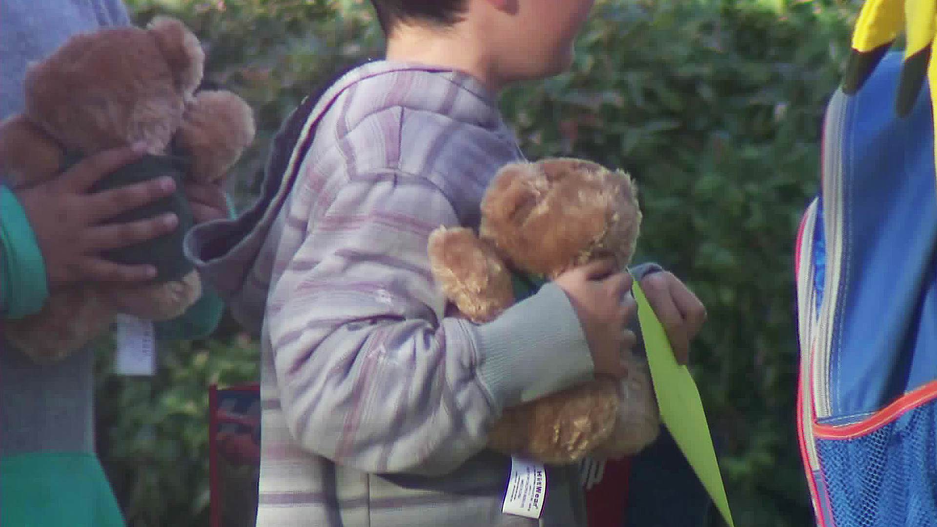 A student holds a teddy bear at Castle View Elementary School in Riverside on Nov. 6, 2017. (Credit: KTLA)