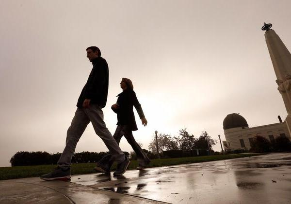 Stefan Campana and his mother, Marcia Campana, walk under the gray morning sky at Griffith Observatory on Nov. 27, 2017. (Credit: Al Seib / Los Angeles Times)