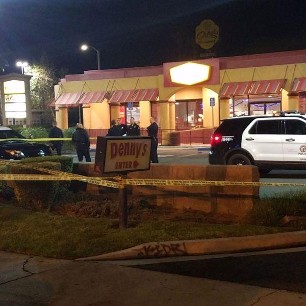 Police respond to a shooting outside a Denny's restaurant on Dec. 15, 2017 (Credit: Chris Gierowski, KTLA)