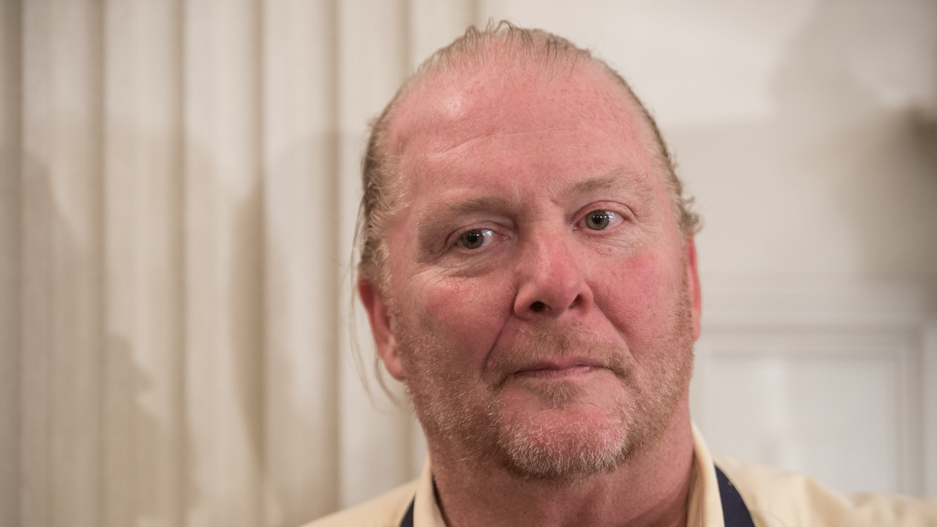 Chef Mario Batali looks on at the White House in Washington, DC, on Oct. 17, 2016, during a preview of the state dinner to be held the following day for Italian Prime Minister Matteo Renzi and his wife Agnese Landini. (Credit: Nicholas Kamm/AFP/Getty Images)