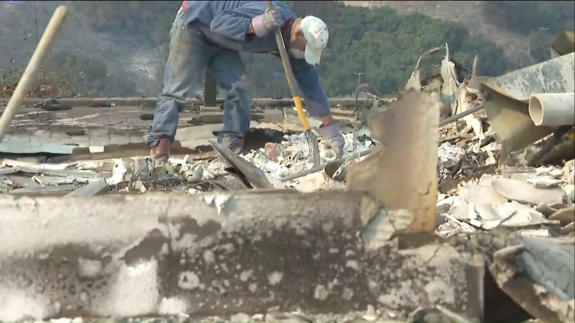 A man sifts through the remains of his home in Ventura Dec. 6, 2017. (Credit: KTLA)