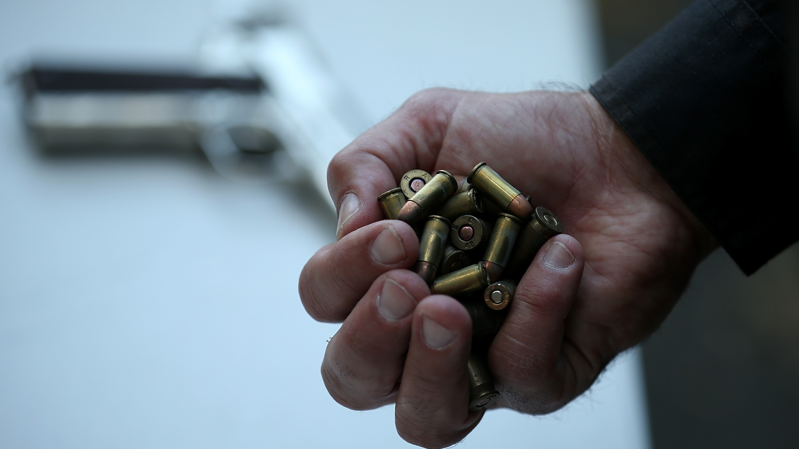 A San Francisco police officer holds a handful of ammunition that was surrendered during a gun buyback event in San Francisco on Aug, 8, 2013. (Justin Sullivan / Getty Images)