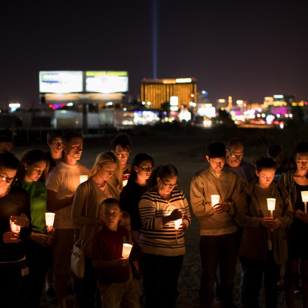 At the corner of Sunset Road and Las Vegas Blvd., mourners attend a candlelight vigil for the victims of Sunday night's mass shooting, October 3, 2017 in Las Vegas, Nevada. (Credit: Drew Angerer/Getty Images)