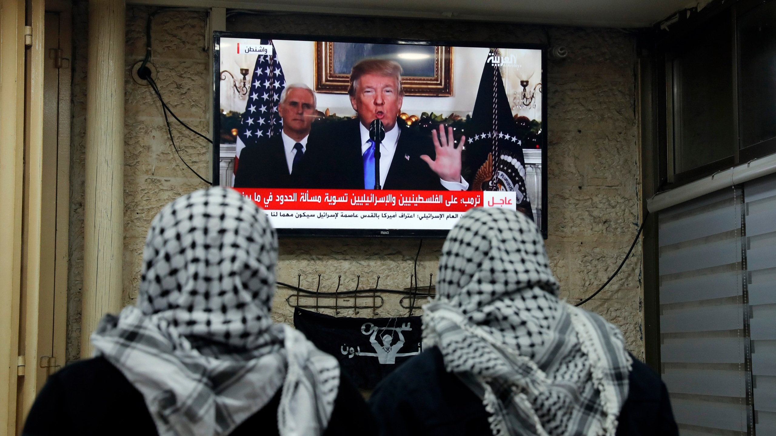 A photo taken on Dec. 6, 2017 shows Palestinian men watching an address given by Donald Trump at a cafe in Jerusalem. (Credit: AHMAD GHARABLI/AFP/Getty Images)