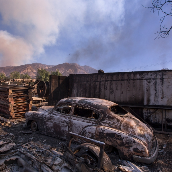 A burned classic car is seen in Little Tujunga Canyon during the Creek Fire on Dec. 6, 2017 near Sylmar, California. (Credit: David McNew/Getty Images)