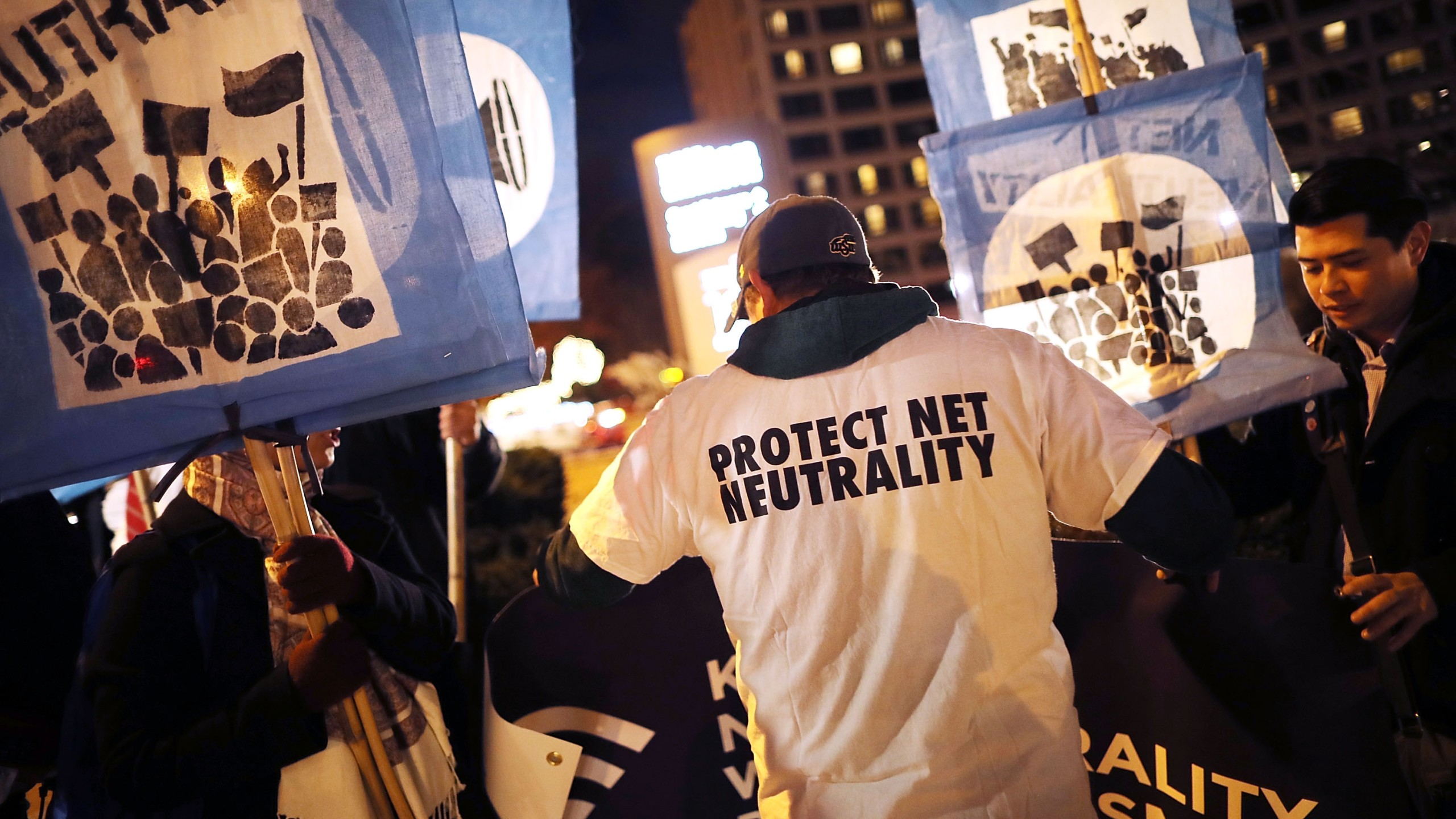 About 60 demonstrators gather outside of the 31st Annual Chairman's Dinner to show their support for net neutrality at the Washington Hilton December 7, 2017 in Washington, United States. (Credit: Chip Somodevilla/Getty Images)