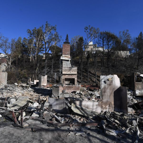 A burnt out house is seen after the Skirball wildfire swept through the exclusive enclave of Bel-Air on Dec. 7, 2017. (Credit: AFP PHOTO / Mark Ralston)