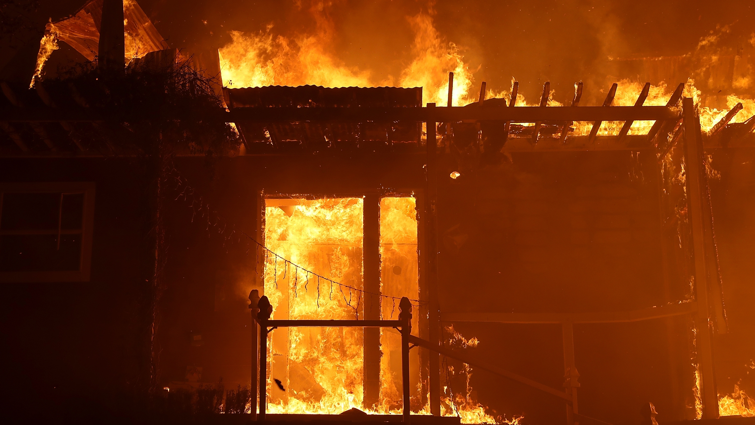 A home is consumed by fire during the Thomas fire on Dec. 7, 2017, in Ojai. (Credit: Justin Sullivan/Getty Images)
