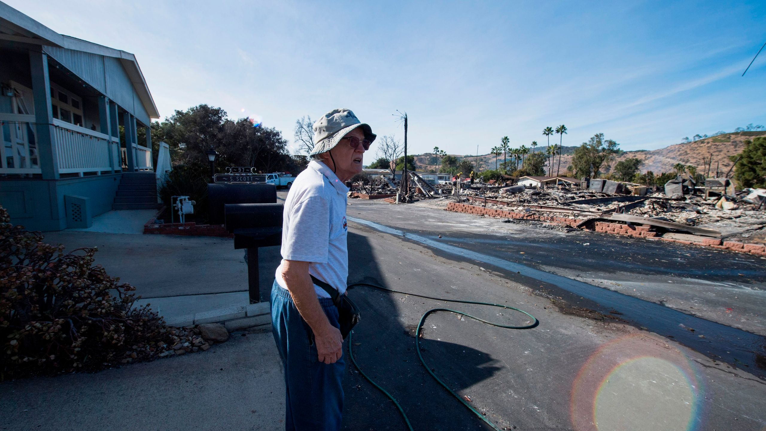 Local resident Pal Paricsy looks over the remains of his neighbors' homes destroyed by the Lilac Fire, Dec. 8, 2017, at a retirement community in Fallbrook, in San Diego County. (Credit: AFP PHOTO / Robyn Beck)