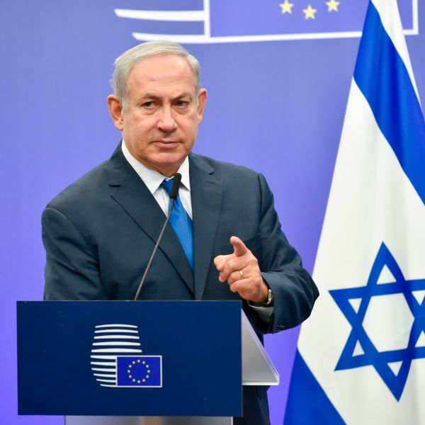 Israel's Prime Minister Benjamin Netanyahu gestures as he speaks during a joint press conference with the EU foreign policy chief, at the European Council in Brussels on December 11, 2017. (Credit: JOHN THYS/AFP/Getty Images)