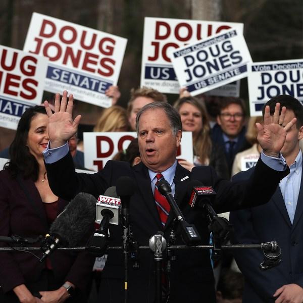 Democratic senatorial candidate Doug Jones speaks to reporters after voting at Brookwood Baptist Church on December 12, 2017 in Mountain Brook, Alabama. (Credit: Justin Sullivan/Getty Images)