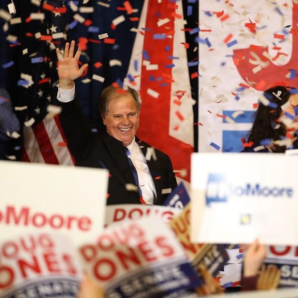 Democratic U.S. Senator elect Doug Jones greets supporters during his election night gathering the Sheraton Hotel on December 12, 2017 in Birmingham, Alabama. (Credit: Justin Sullivan/Getty Images)