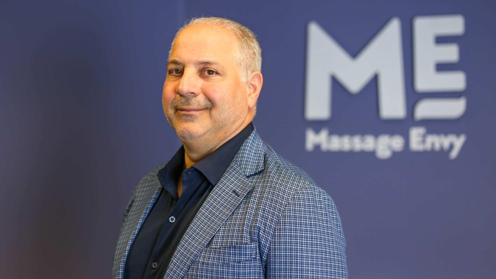 Massage Envy CEO Joe Magnacca appears in an undated photo provided by the company to KTLA.