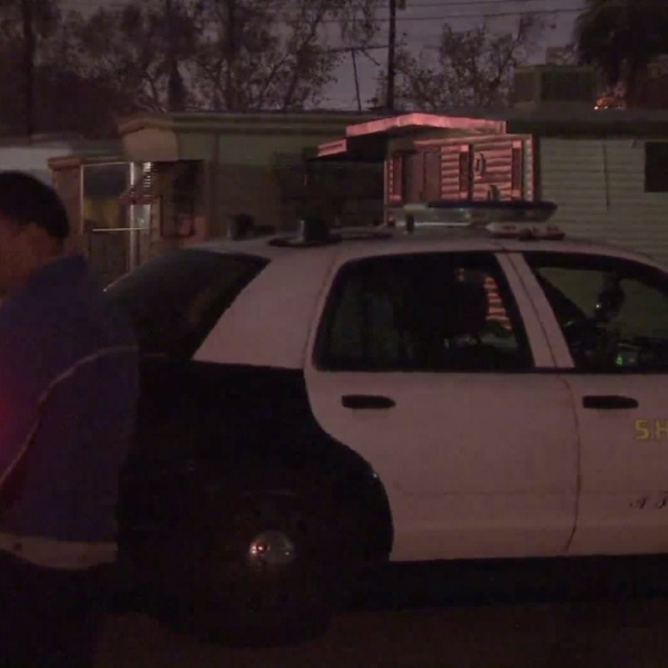 The L.A. County Sheriff's Department investigates a shooting that left a woman dead and the suspect injured in Bellflower on Dec. 25, 2017. (Credit: KTLA)