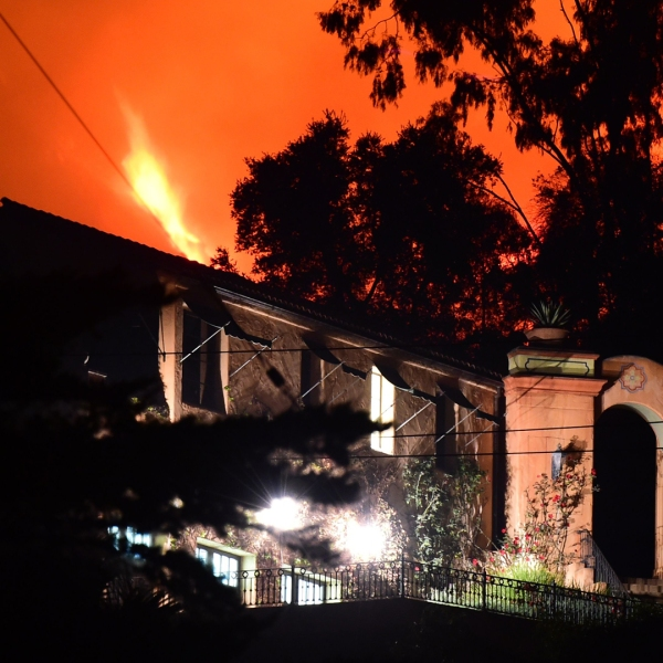 Flames from the Thomas Fire burn in the hills above homes in Montecito on Dec. 11, 2017. Mandatory evacuations were ordered in the area on Dec. 16, 2017. (Credit: Robyn Beck/AFP/Getty Images)