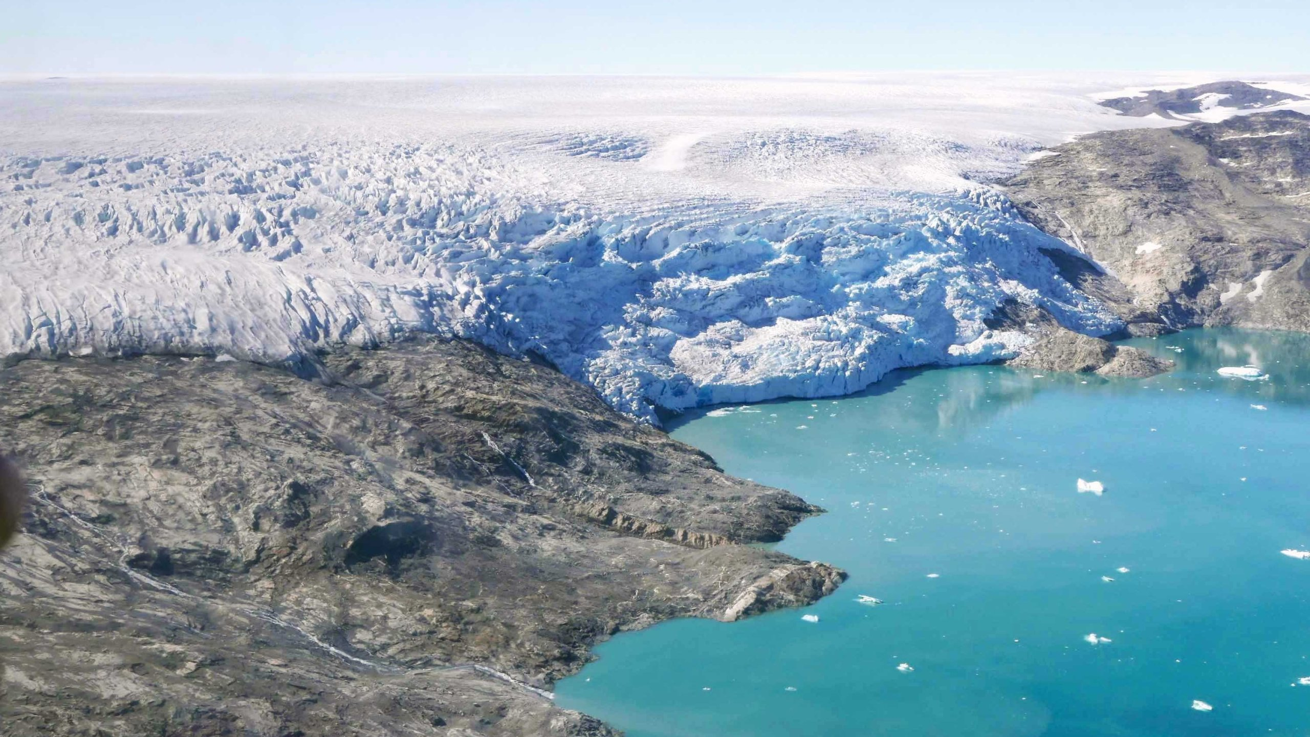 Ice flows from Helheim Glacier into Sermilik Fjord, in eastern Greenland. (Credit: Christian Steib/CNN)