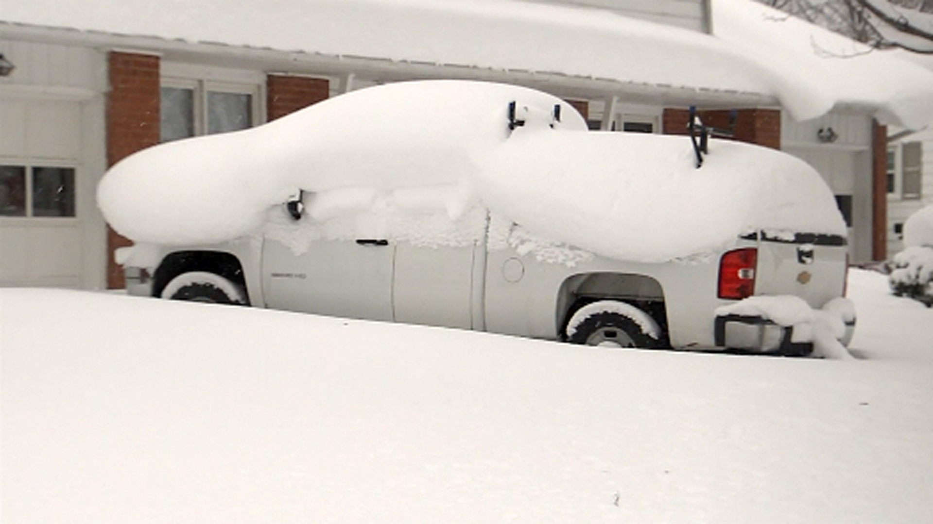 A truck is seen covered in snow in Erie, Pennsylvania. (Credit: CNN)